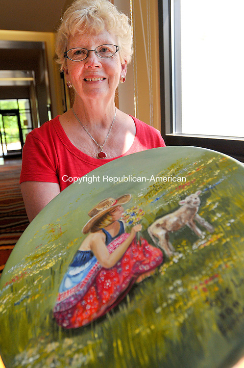 LITCHFIELD, CT, 29 JUNE 2011-062911JS03-- COUNTRY LIFE ONLY-Torrington artist Joyce Lawton shows off a one of her hand-painted stools she painted that will be part of a Silent Auction for the Litchfield Community Center's Summerfest event. Summerfest runs from July 18-23 with events scheduled throughout the week. The Silent Auction for the painted country furniture and stools by local artists will be held during &quot;A Country Affair&quot; dinner and dance Saturday June 23 from 6-11 p.m.<br /> Jim Shannon/Republican-American
