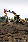 This image is FREE to use - The Winchburgh Development - a partnership between local landowners and project managers Sigma Capital - got underway today (16th July) heralding the creation of West Lothian's sixth largest town and what is believed to be Scotland's largest urban renewal project. The £1bn fifteen year development will see 300 jobs sustained annually in construction and some 3450 new homes over time. A community benefit clause agreed with developers will trigger a £1.27 million contribution towards West Lothian Council's cost in extending Linlithgow Academy which was completed last year. Picture shows Alex Neil MSP - Cabinet Secretary for Infrastructure and Capital Investment - on a visit to the site to help earthmovers cut the first turf of the development - with John Hamilton (right - Director - Sigma Capital) - for further information please contact Ewan Hunter (Sigma Capital - on 07803 904 769) or Iain Monk (Scottish Government on 07771 555 601 or http://www.scotland.gov.uk/News/Releases/2012/07/west-lothian-construction16072012) - picture by Donald MacLeod - 16.7.12 - 07702 319 738 - clanmacleod@btinternet.com - www.donald-macleod.com