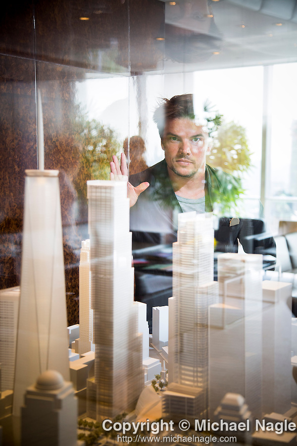 Danish architect Bjarke Ingels poses for a portrait with a model of his 2 World Trade Center design in New York, U.S., on Friday, June 12, 2015.  Photographer: Michael Nagle
