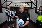 The match referee shaking hands with home team captain Dale Whitham in the tunnel at Victory Park, before Chorley played Altrincham in a Vanarama National League North fixture. Chorley were founded in 1883 and moved into their present ground in 1920. The match was won by the home team by 2-0, watched by an above-average attendance of 1127.