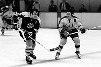 Boston Bruins vs California Golden Seals: Bruins Phil Esposito and the Seals Rick Smith.(1973 photo by Ron Riesterer)