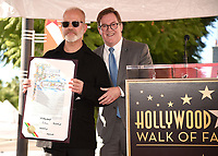 HOLLYWOOD, CALIFORNIA - DECEMBER 4: (L-R) Ryan Murphy and Kevin James attend a ceremony honoring Ryan Murphy with a star on The Hollywood Walk of Fame on December 4, 2018 in Hollywood, California. (Photo by Frank Micelotta/Fox/PictureGroup)