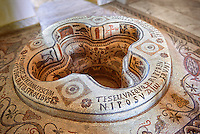 Eastern Roman Byzantine walk in baptismal font from the 6th century AD Parish Church of Demna near Kalibia, Cape Bon, Tunisia. <br /> <br /> The baptismal font was removed from the church and restored in the Bardo Museum Tunis in 1955. <br /> <br /> The mosaic iconographic decorations represent the salvation of the neophyte, newcomer, who by being baptised is admitted into the Church of Christ whilst being illuminated by faith, represented the mosaic lit candle illustrations.<br /> <br /> The P with a cross through it is the Chi Rho, a Christian symbol which represent the first two letters of Jesus Christ's name in Greek. The Christogram also has the Greek letters Alpha and Omega which represent the passage from the book of revelations: &ldquo;I am the Alpha and Omega&quot; Chapter 1 verse 8, which is clarified by &quot;the beginning and the end&quot; (Revelation 21:6, 22:13). <br /> <br /> In these type of baptismal fonts those being baptised would have been fully immersed in water as John the Baptist immersed Jesus. <br /> <br /> The font was paid for by donation by Iuliana and Aquinius who dedicated the font to St Cyprian, the martyed Bishop of Carthage, circa 258,  and the author of a treatise on baptism rites<br /> <br /> The Bardo Museum Tunis