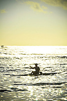 Outrigger surf ski paddler at Poipu Beach, Kauai Hawaii