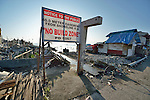 A government-erected sign prohibits rebuilding within 40 meters of the waterfront in Tacloban, a city in the Philippines province of Leyte that was hit hard by Typhoon Haiyan in November 2013. The storm was known locally as Yolanda.
