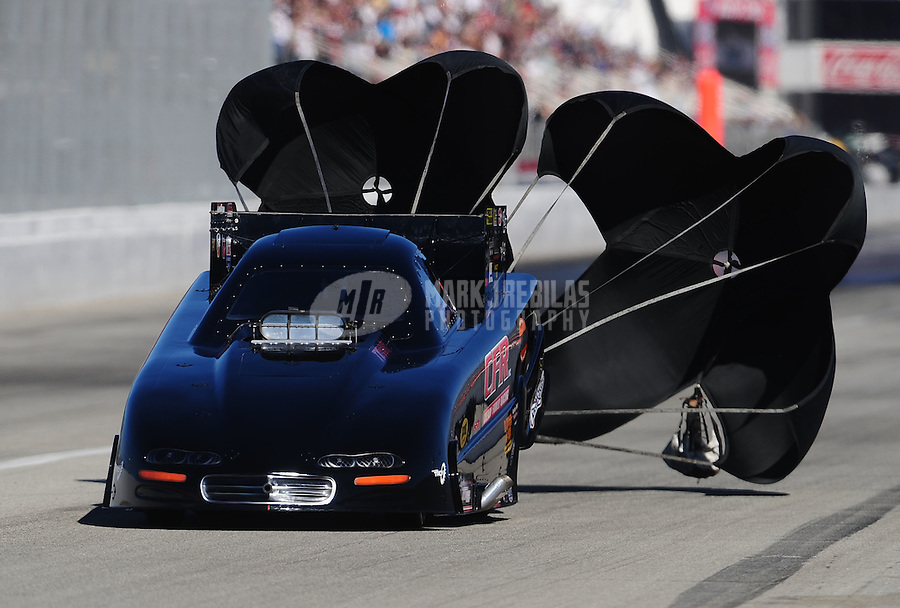 Nov 13, 2010; Pomona, CA, USA; NHRA funny car driver Justin Schriefer during qualifying for the Auto Club Finals at Auto Club Raceway at Pomona. Mandatory Credit: Mark J. Rebilas-