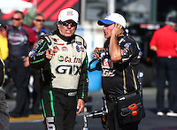 Jul. 26, 2013; Sonoma, CA, USA: NHRA funny car driver John Force (left) with track specialist Lanny Miglizzi during qualifying for the Sonoma Nationals at Sonoma Raceway. Mandatory Credit: Mark J. Rebilas-
