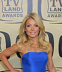 "All My Children Kelly Ripa wearing Jason Wu hosts the 10th Anniversary of the TV Land Awards on April 14, 2012 to honor shows ""Murphy Brown"", ""Laverne & Shirley"", ""Pee-Wee's Playhouse"", ""In Loving Color"" and ""One Day At A Time"" and Aretha Franklin at the Lexington Armory, New York City, New York. (Photo by Sue Coflin/Max Photos)"