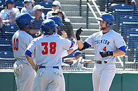 Seth Brown (4) of the Stockton Ports is greeted by teammates James Harris (10) and Tyler Ramirez (38) after hitting a home run during a game against the Rancho Cucamonga Quakes at LoanMart Field on May 28, 2017 in Rancho Cucamonga, California. Stockton defeated Rancho Cucamonga, 7-4. (Larry Goren/Four Seam Images)