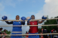 INDIA (West Bengal - Calcutta) August 2010,Shakila Babe(left) and Sanno Babe (right) during practice in a local boxing club. Shakila and Shanno are twins from a poor muslim family of Iqbalpur, Kolkata. . Inspite of their late father's unwillingness to send his daughters to take up  boxing her mother Banno Begum inspired them to take up boxing at the age of 3. Their father was more concerned about the social stigma they have in their community regarding women coming into sports or doing anything which may show disrespect to the religious emotions of his community. Shakila now has been recognised as one of the best young woman boxers of the country after she won the  international championship at Turkey in the junior category. Shanno is also been called for the National camp this year. Presently Shakila and shanno has become the role model in the Iqbalpur area  and parents from muslim community of Iqbalpur have started showing interst in boxing. Iqbalpur is a poor muslim dominated area mostly covered with shanty town with all odds which comes along with poverty and lack of education. - Arindam Mukherjee