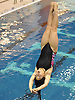 Renee Lee of Jericho soars through the air during the Nassau County girls' diving championship and state qualifier at Nassau Aquatic Center on Wednesday, November 4, 2015.<br /> <br /> James Escher
