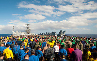 100103-N-7981E-258 PACIFIC OCEAN (Jan. 3, 2011)- Sailors conduct a Foreign Object Damage (FOD) walk down after an abandon ship drill on the flight deck aboard USS Carl Vinson (CVN 70).  Carl Vinson and Carrier Air Wing (CVW) 17 are on a deployment to the U.S. 7th and U.S. 5th Fleet areas of responsibility. (U.S. Navy photo by Mass Communication Specialist 2nd Class James R. Evans / RELEASED)