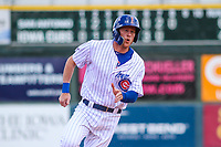 Iowa Cubs first baseman Jim Adduci (17) races to third base during a Pacific Coast League game against the San Antonio Missions on May 2, 2019 at Principal Park in Des Moines, Iowa. Iowa defeated San Antonio 8-6. (Brad Krause/Four Seam Images)