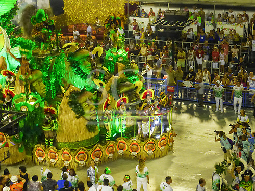Imperatriz Leopolinense Samba School, Carnival, Rio de Janeiro, Brazil, 26th February 2017. The 'Beautiful Monster' - Belo Monstro - float, with the monster in the middle threatening the birds and the animals and the people of the forest, and Chief Raoni Metuktire in front to fight the invaders. The Kayapo Indian chiefs and leaders are at the front of the float.