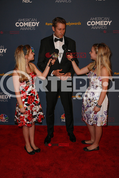 New York, New York - April 26 : Scott Aukerman is interviewed by Hannah and Cailin Loesch of Teen Kids News at the American Comedy<br /> Awards held at the Hammerstein Ballroom in New York, New York<br /> on April 26, 2014.<br /> Photo by Brent N. Clarke / Starlitepics /NortePhoto