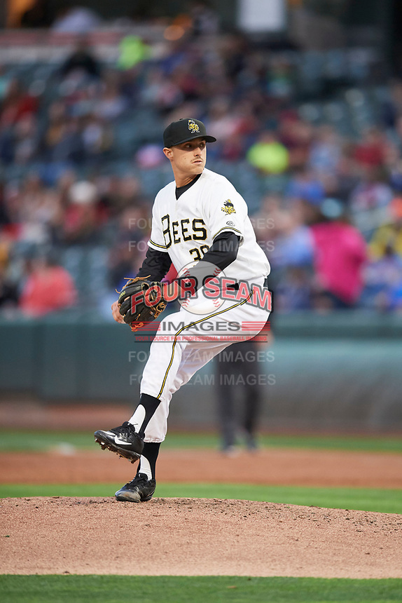 Ralston Cash (30) of the Salt Lake Bees delivers a pitch to the plate against the Albuquerque Isotopes at Smith's Ballpark on April 5, 2018 in Salt Lake City, Utah. Salt Lake defeated Albuquerque 9-3. (Stephen Smith/Four Seam Images)