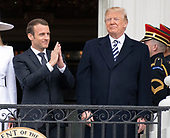 President Emmanuel Macron of France acknowledges the applause of the crowd as United States President Donald J. Trump looks on following an arrival ceremony on the South Lawn of the White House in Washington, DC on Tuesday, April 24, 2018.<br /> Credit: Ron Sachs / CNP