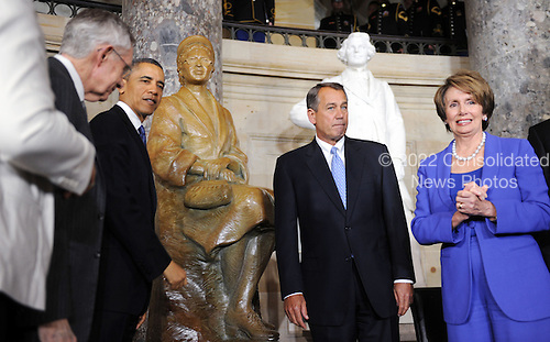 United States President Barack Obama flanked by U.S. Senate Majority Leader Harry Reid (Democrat of Nevada), left, Speaker of the U.S. House John Boehner (Republican of Ohio), and U.S. House Democratic Leader Nancy Pelosi(Democrat of California), right, unveil the statue of Rosa Parks in Statuary Hall of the United States Capitol February 27, 2013 in Washington, DC. .Credit: Olivier Douliery / Pool via CNP