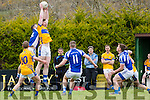Cian Horan Glenflesk gets a great catch ahead of  Templenoe Sean Sheehan during their Intermediate Championship clash in Glenflesk on Sunday