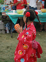 Children and adult experience traditional Japanse food, clothes and activities such as Sumo wrestling during a Japanese festival held outdoor in Montreal's Old-Port<br />