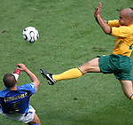 26 June 2006: Fabio Cannavaro (ITA) (5) clears the ball away from onrushing Marco Bresciano (AUS) (right). Italy (1st place in Group E) defeated Australia (2nd place in Group F) 1-0 at Fritz-Walter Stadion in Kaiserslautern, Germany in match 53, a Round of 16 game, in the 2006 FIFA World Cup.