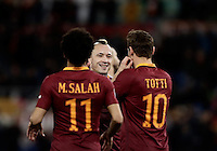 Calcio, Serie A: Roma, stadio Olimpico, 19 febbraio 2017.<br /> Roma&rsquo;s Radja Nainggolan (c) celebrates with his teammates Mohamed Salah (l) and Francesco Tott (r)i after scoring during the Italian Serie A football match between As Roma and Torino at Rome's Olympic stadium, on February 19, 2017.<br /> UPDATE IMAGES PRESS/Isabella Bonotto