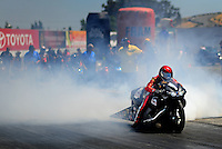 Jul. 17, 2010; Sonoma, CA, USA; NHRA pro stock motorcycle rider Angie Smith does a burnout during qualifying for the Fram Autolite Nationals at Infineon Raceway. Mandatory Credit: Mark J. Rebilas-