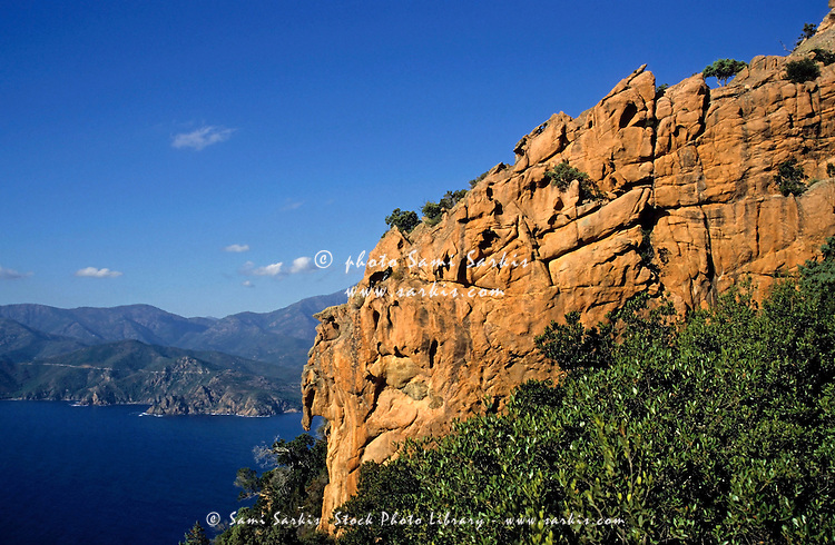 Rock formations of cliffs with Mediterranean Sea below, Piana Calanches, Corsica, France.