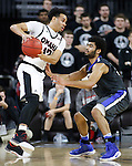 SIOUX FALLS, SD: MARCH 5: Daniel Norl #13 of Omaha looks past IPFW defender Kason Harrell #32 during the Summit League Basketball Championship on March 5, 2017 at the Denny Sanford Premier Center in Sioux Falls, SD. (Photo by Dick Carlson/Inertia)