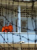 Barb Wire and Buddhist Monks at S-21 Phnom Penh Town Cambodia, Tuol Sleng In Phnom Penh one of the largest secondary schools under the rule of Pol Pot was turned into a torture camp and prison called S21. ...