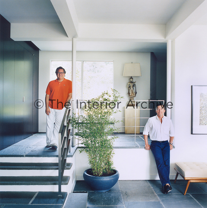 Bruce Glickman and Wilson Henley in the contemporary hallway of their home