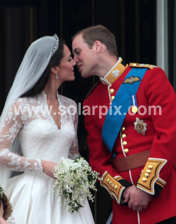 **ALL ROUND PICTURES FROM SOLARPIX.COM**                                             **NO UK NEWSPAPER PUBLICATION**.**UK MAGAZINE & SUPPLEMENT PUBLICATION ONLY** AND NO PUBLICATION IN AUSTRALIA, BELGIUM, FRANCE, GERMANY, ITALY, SCANDINAVIA AND USA**                                                                                  Caption: Prince William and Kate Middleton kiss on the balcony of Buckingham Palace after their wedding at Westminster Abbey. London, UK. 29 April 2011                                                                              This pic: Prince William and Kate Middleton                                          JOB REF: 13229 SFE       DATE: 29_04_2011                                                           **MUST CREDIT SOLARPIX.COM OR DOUBLE FEE WILL BE CHARGED**                                                                      **MUST AGREE FEE BEFORE ONLINE USAGE**                               **CALL US ON: +34 952 811 768 or LOW RATE FROM UK 0844 617 7637**