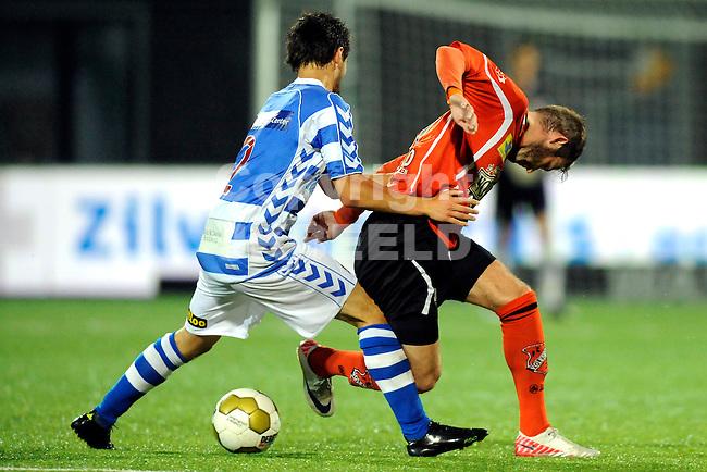 ZWOLLE - Voetbal, FC Zwolle - FC Volendam , seizoen 2011-2012, 16-09-2011  Zwolle speler Bram van Polen met Volendam speler Dominique van Dijk (r). ANP PRO SHOTS