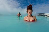Tilda, with red hair rastas bathing in the Blue Lagoon in Reykjavik, Iceland. Hurtigruten cruise.