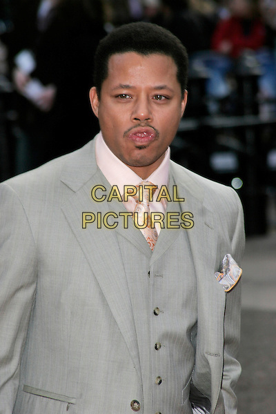 "TERRENCE HOWARD.UK Premiere of ""Iron Man"" at the Odeon, Leicester Square, London, England. .April 24th 2008.half length grey gray suit waistcoat funny face tongue cleaning teeth facial hair .CAP/AH.©Adam Houghton/Capital Pictures."