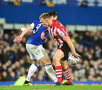 Lincoln City's Harry Anderson battles with Everton's Leighton Baines<br /> <br /> Photographer Andrew Vaughan/CameraSport<br /> <br /> Emirates FA Cup Third Round - Everton v Lincoln City - Saturday 5th January 2019 - Goodison Park - Liverpool<br />  <br /> World Copyright &copy; 2019 CameraSport. All rights reserved. 43 Linden Ave. Countesthorpe. Leicester. England. LE8 5PG - Tel: +44 (0) 116 277 4147 - admin@camerasport.com - www.camerasport.com