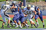 Torrance, CA 09/08/11 - Harper Harrington (Peninsula #66), Noah Stettler (Peninsula #62) and unidentified North players in action during the North-Peninsula Junior Varsity Football game at North High School in Torrance.