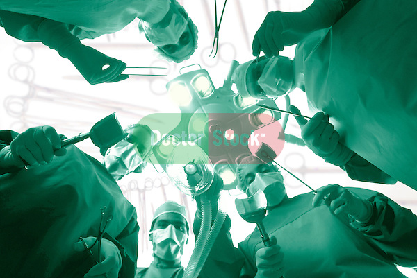 dramatic worms-eye-view from patient's perspective of surgical team gathered around operating table, green duotone