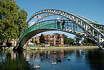Victorian footbridge over the River Great Ouse at Bedford with Embankment in the distance