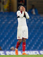 Tyreece John-Jules of Arsenal U18 covers his face as his side concede a third goal during the FA Youth Cup FINAL 1st leg match between Chelsea U18 and Arsenal U18 at Stamford Bridge, London, England on 27 April 2018. Photo by Andy Rowland.