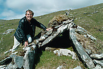 The joy of discovery. Archaeologist Michael Gibbons shows his delight just moments after finding an unrecorded megalithic tomb on Mt. Brandon this week. <br />