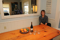 NWA Democrat-Gazette/FLIP PUTTHOFF<br /> The banquette in her kitchen is a favorite place    Dec. 17, 2015    for Kassie Misiewicz of Bentonville. Bench seats at the table mean there is always room for one more at meal time.