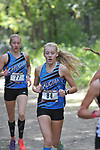 Chugiak's Adrianna Proffitt, who placed ninth  with a time of 19:37.19 leads teammate Brooklyn Gould, who placed 19th with a time of 20:26.20 at the Palmer Invitational Saturday, Sept 2, 2017.  Photo for the Star by Michael Dinneen