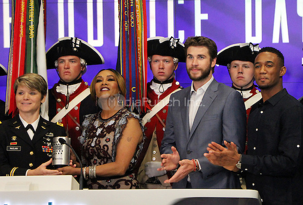 NEW YORK, NY-June 14: Vivica A. Fox, Liam Hemsworth, Jessie T. Usher from the cast of  Independence Day: Resurgence ring Nasdaq Stock Open Bell  at Nasdaq Time Square in New York. NY June 14, 2016. Credit:RW/MediaPunch