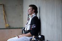 Winston-Salem Dash starting pitcher Spencer Adams (12) sits in the dugout while his team bats against the Salem Red Sox at BB&T Ballpark on June 16, 2016 in Winston-Salem, North Carolina.  The Dash defeated the Red Sox 7-1.  (Brian Westerholt/Four Seam Images)