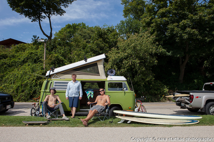 Three surfer buddies from Wisconsin hang out at their vintage Volkswagon on the afternoon of the Dairyland Surf Classic.