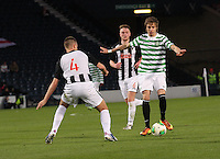 Patrik Twardzik  takes on Kerr Young in the Dunfermline Athletic v Celtic Scottish Football Association Youth Cup Final match played at Hampden Park, Glasgow on 1.5.13. ..