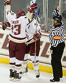 Cam Atkinson (BC - 13) and Brian Gibbons (BC - 17) celebrate Atkinson's goal which tied the game at 1 midway through the first period. - The Boston College Eagles defeated the visiting Boston University Terriers 5-2 on Saturday, December 4, 2010, at Conte Forum in Chestnut Hill, Massachusetts.