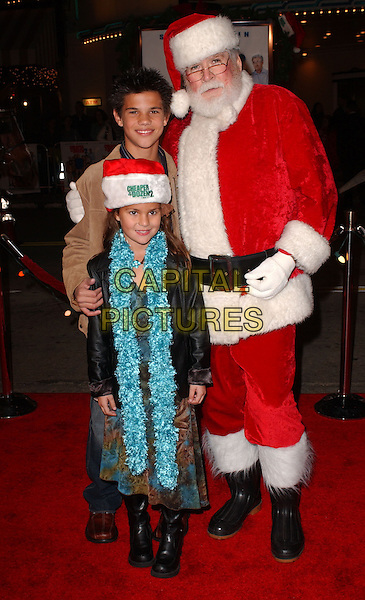 "TAYLOR DANIEL LAUTNER, MACKENNA LAUTNER & SANTA CLAUS.World Premiere of ""Cheaper by The Dozen 2"" held at The Mann Village Theatre in Westwood, California   .December 13th, 2005.Ref: DVS.full length blue boa scarf hat santa red dress up costume.www.capitalpictures.com.sales@capitalpictures.com.Supplied By Capital PIctures"