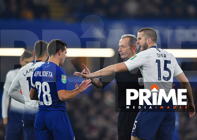 Eric Dier of Tottenham Hotspur talks to Referee Martin Atkinson as César Azpilicueta of Chelsea looks on during the Carabao Cup Semi-Final 2nd leg match between Chelsea and Tottenham Hotspur at Stamford Bridge, London, England on 24 January 2019. Photo by Vince  Mignott / PRiME Media Images.
